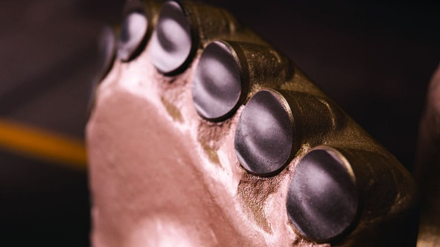 Distinctively shaped cutting elements improve drill bit rate of penetration