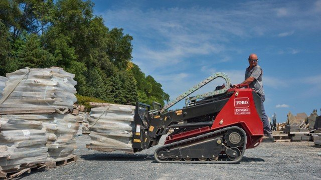 Newest machine boasts innovative telescoping loader arms, 2-ton rated operating capacity.