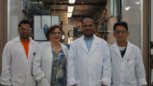 Ziba Hajizadeh, P.Eng. (2nd from left), recently promoted to VP, Engineering, with other Micron Waste R&D team members, including Co-Founder and Chief Technology Officer, Dr. Bob Bhushan (2nd from right) in front of a Cannavore unit.