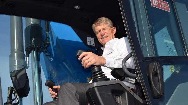 John Garrison, Terex CEO and president in Fuchs' award-winning material handler operator's cab.