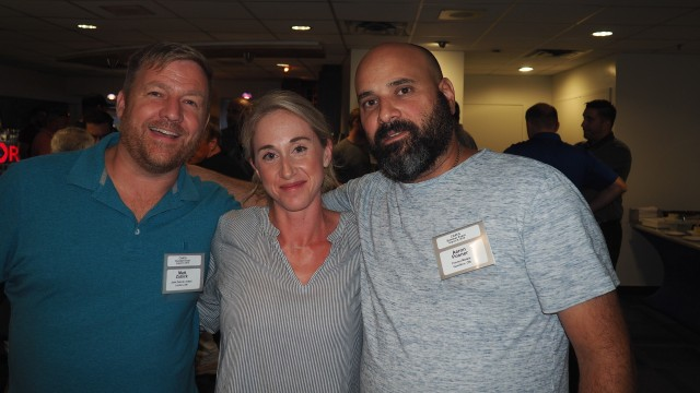 Matt Zubick (left) with CARI's Marie Binette and Peter Racco, of Ram Iron and Metal Inc.,  a current board member, at CARI's annual Blue Jays networking event in August.