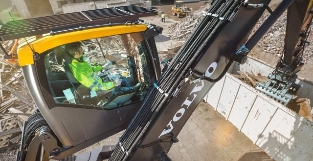 The Volvo EW240E's Hydraulically elevated cab raises 16 feet, and has double-damped cushioning to reduce noise and vibrations, as well as L8 multifunction joystick with Comfort Drive Control (CDC) and a Standard arm-in-limiter prevents grapples and material from contacting the cab.