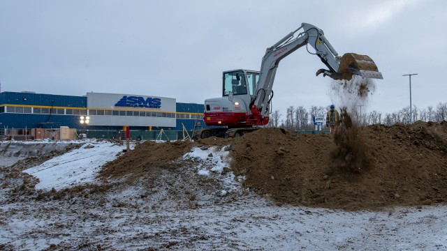 A Takeuchi TB260 at work on the expansion of SMS Equipment headquarters in Acheson, Alberta.