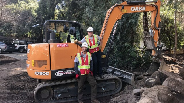 The operation cleared debris from the creek to alleviate ongoing flood risks and further damage to homes in the area. The CASE CX80C was the primary tool for clearing and removing debris.